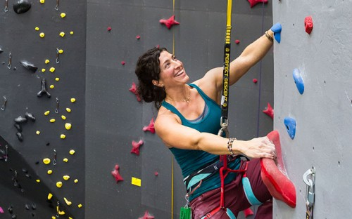 woman-climbing-indoors-smiling-on-perfect-descent-auto-belay.jpg